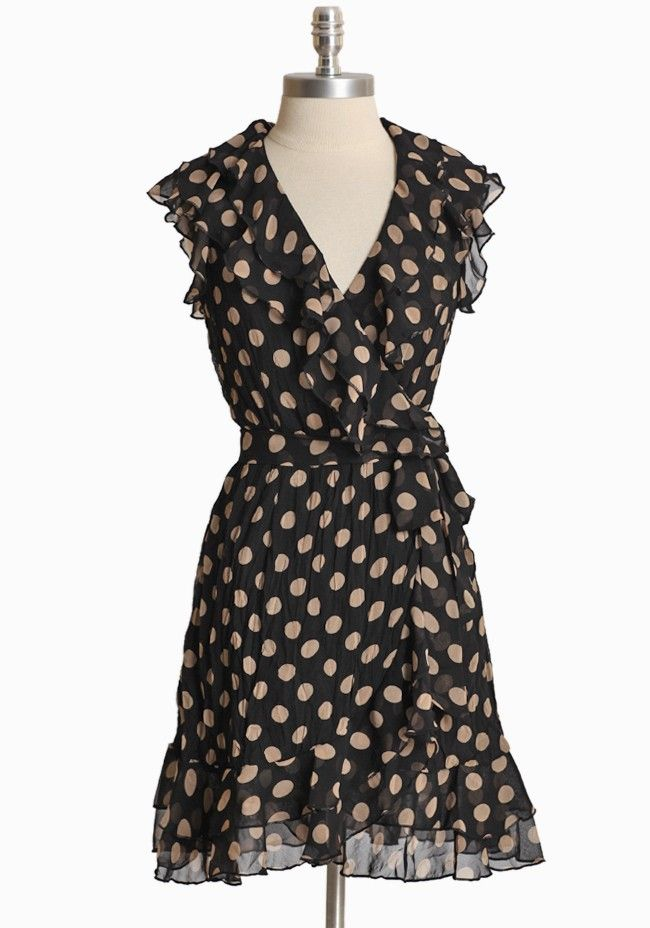 """Belleza Dusk Polka Dot Wrap Dress 52.99 at shopruche.com. Crafted in a classic silhouette, this black and taupe chiffon wrap dress is perfected with a soft texture and ruffled detail.  100% Polyester, Imported, 33.5"""" length"""