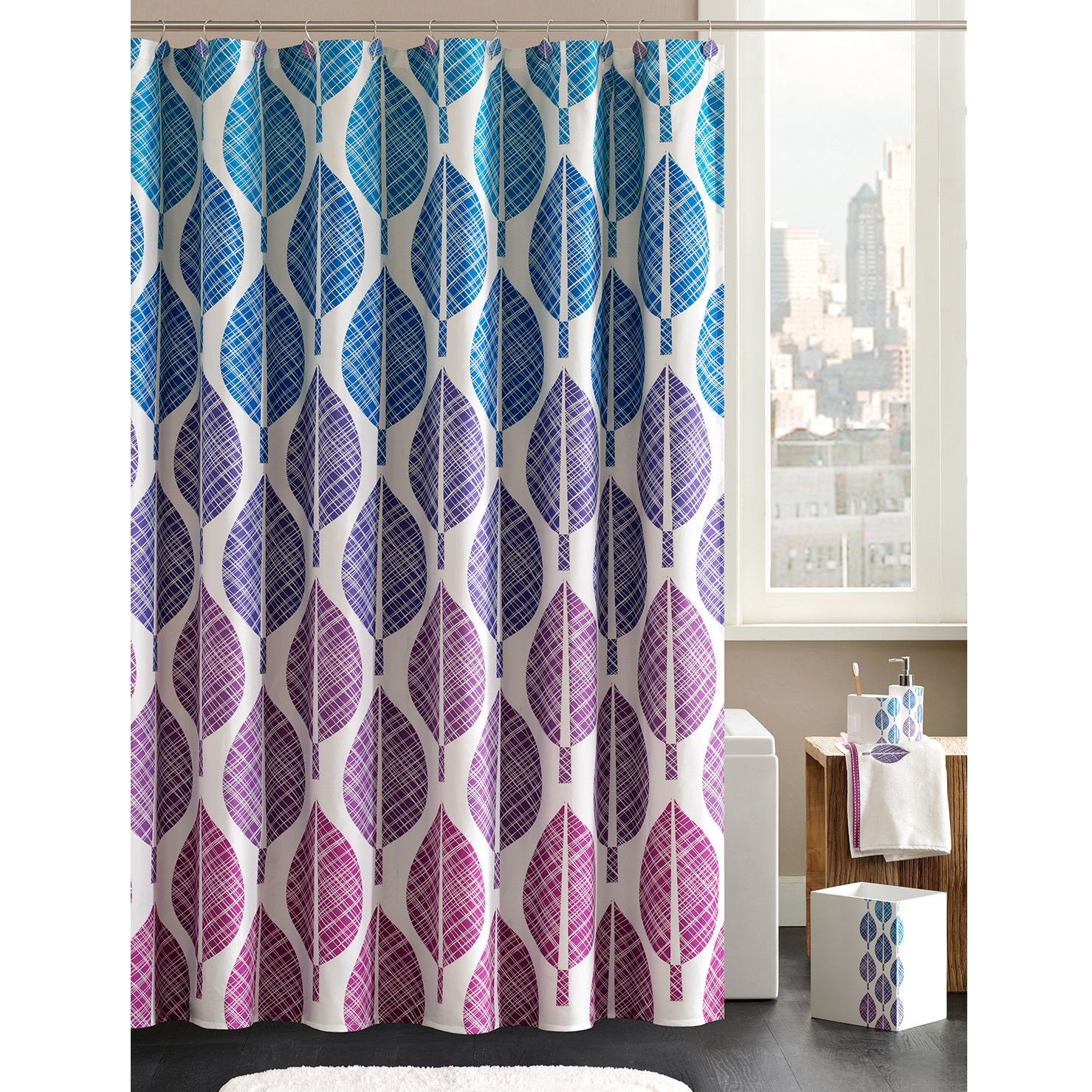 Spruce up your bathroom with this shower curtain set from Madison Park. With a gradient color scheme of blue, purple, and pink, this modern leaf-print shower curtain comes with coordinating shower curtain hooks and is machine-washable for easy care.