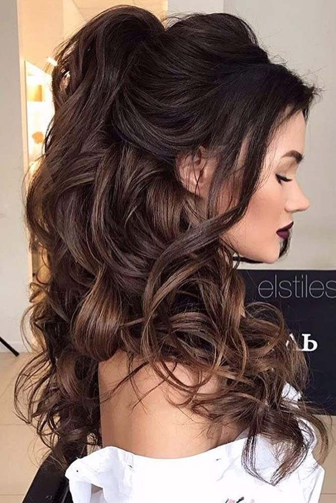 With A Few Strands Of Hair Left Out To Frame The Face This Gorgeous Half Up Half Down Curly Hairstyle Is Stunni Hair Styles Wedding Hair Down Long Hair Styles