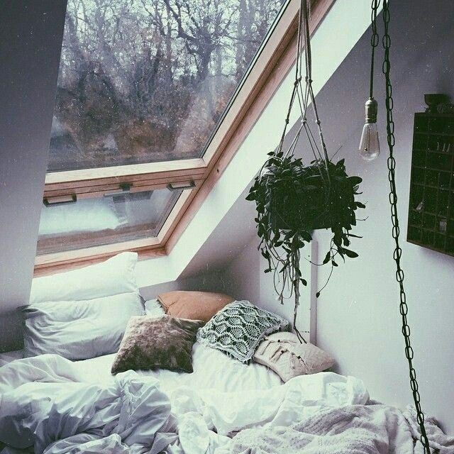 I'd love to lay in that bed and watch the rain fall in that window
