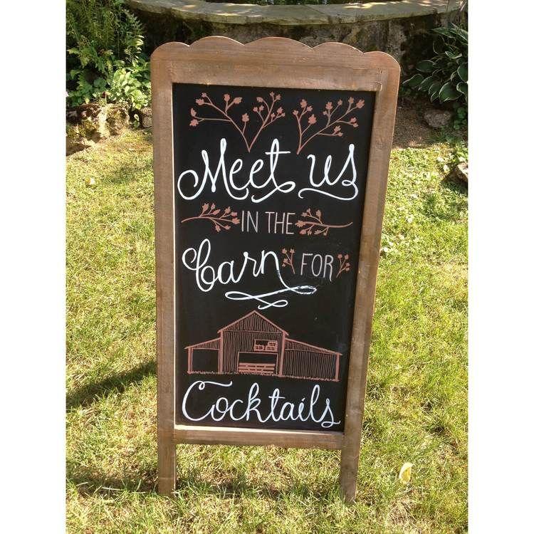 Hand-drawn chalkboard sign for wedding reception