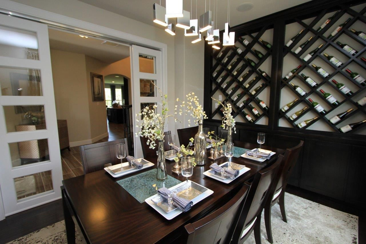 This Spacious Formal Dining Room With A Unique Wine Rack Is