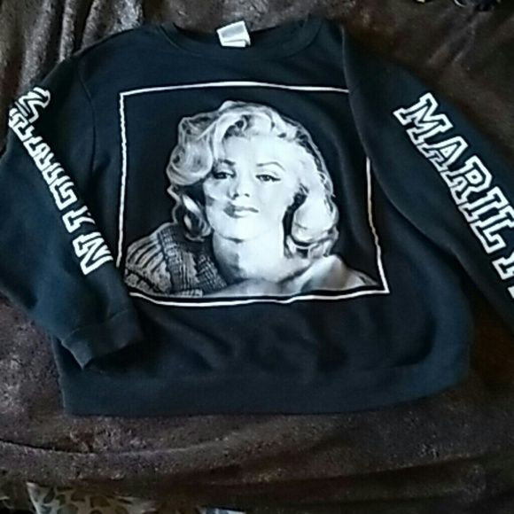 Pull over It marilyn monroe face on the front. Her name is on both sleeves. Has no markes. The lettering is no cracked. marilyn monroe   Sweaters