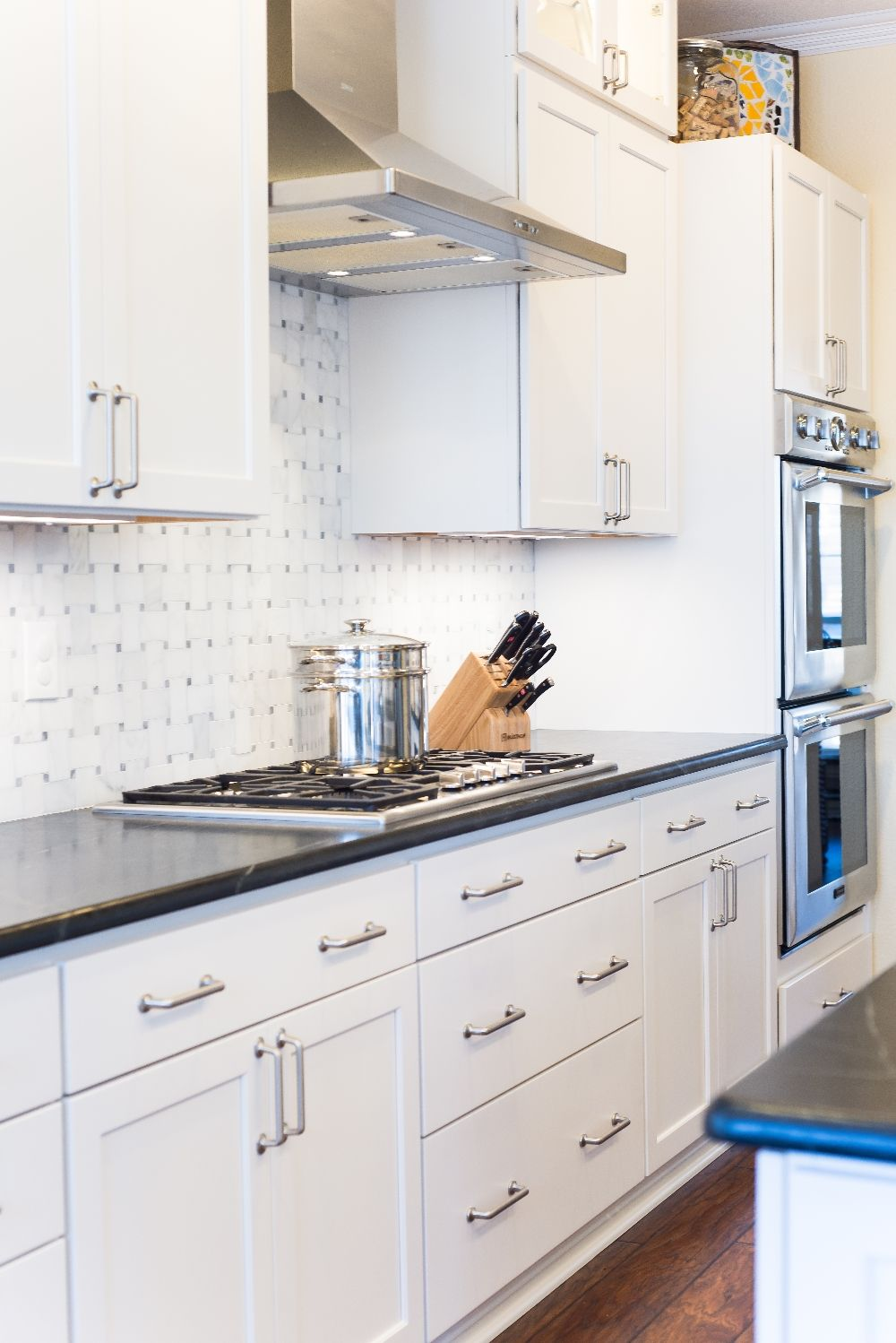 White Shaker Style Cabinets Below Soapstone Countertops Stainless Steel Appliances And A Gas Cooktop Kitchen Remodel White Cooktop Shaker Style Cabinets