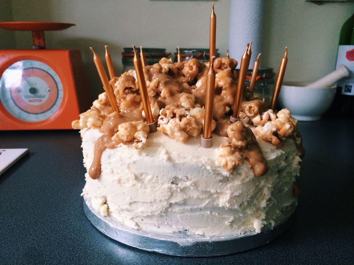 Vegan birthday cake: Chocolate cake, vanilla frosting, caramel and popcorn.