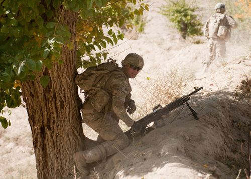 usarmystrong:  United States Army (Sapper)-Pfc. Daniel Beauchamp sets up his M240 Bravo machine gun to provide security after one of the trucks in the convoy was hit by a roadside bomb on the way to Combat Outpost Baraki Barak.