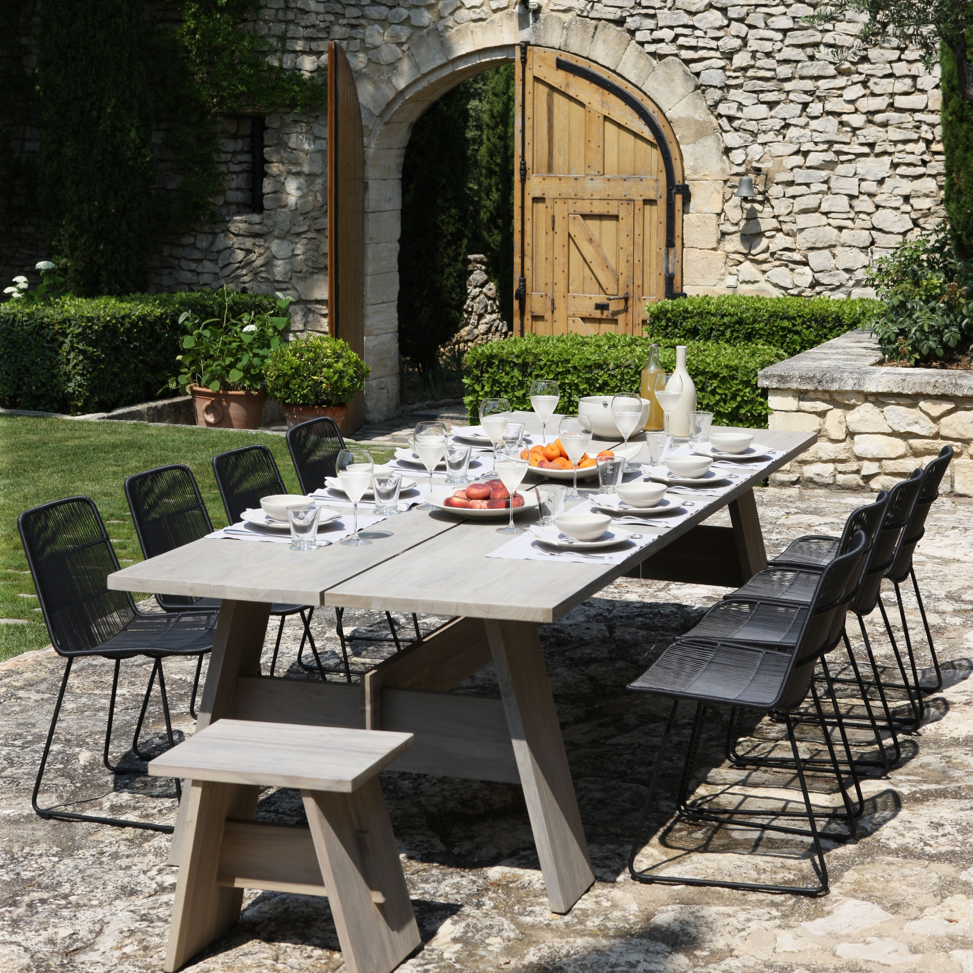 The Bradford Dining Table And Nairobi Black Wicker Dining Chairs