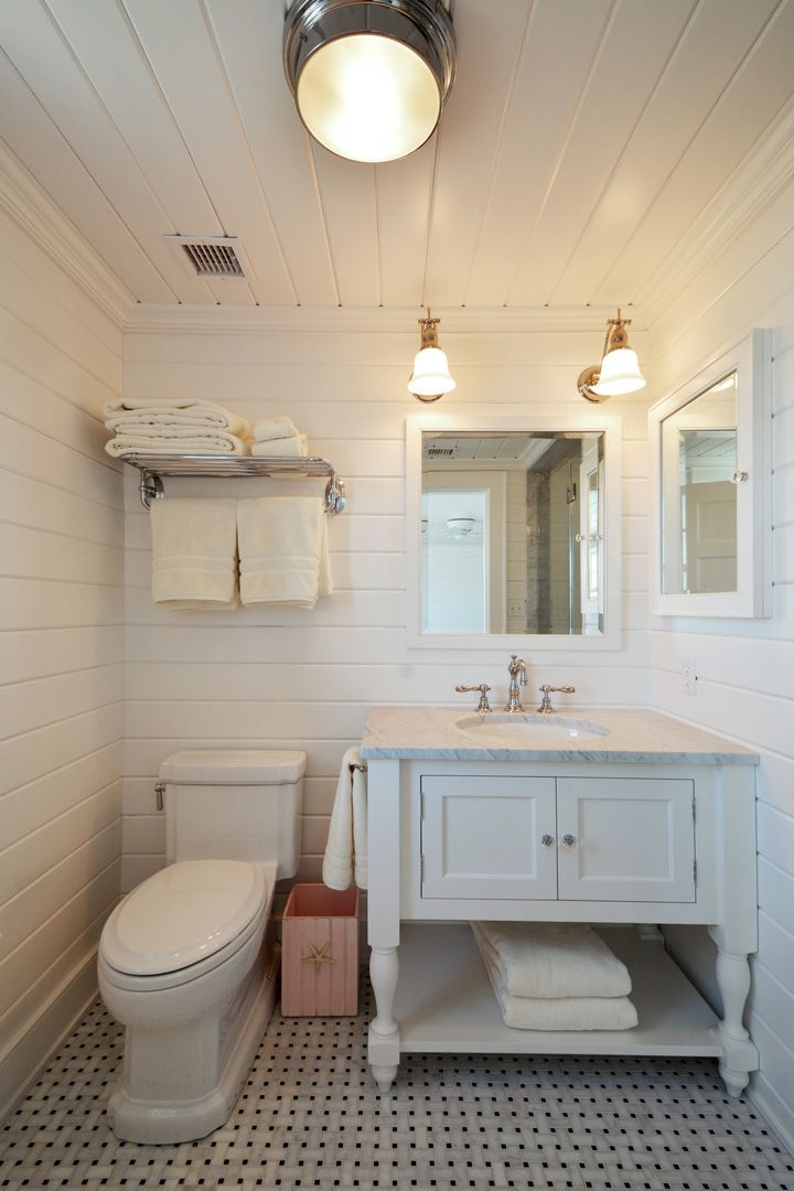 Hamptons Beach House Bathroom With White Shiplap Walls And
