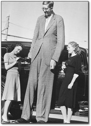 That's Robert Wadlow of Alton, Illinois, widely believed to be the tallest man who ever lived, at 8 feet 11 inches. He weighed almost 500 pounds and had size 37AA shoes.