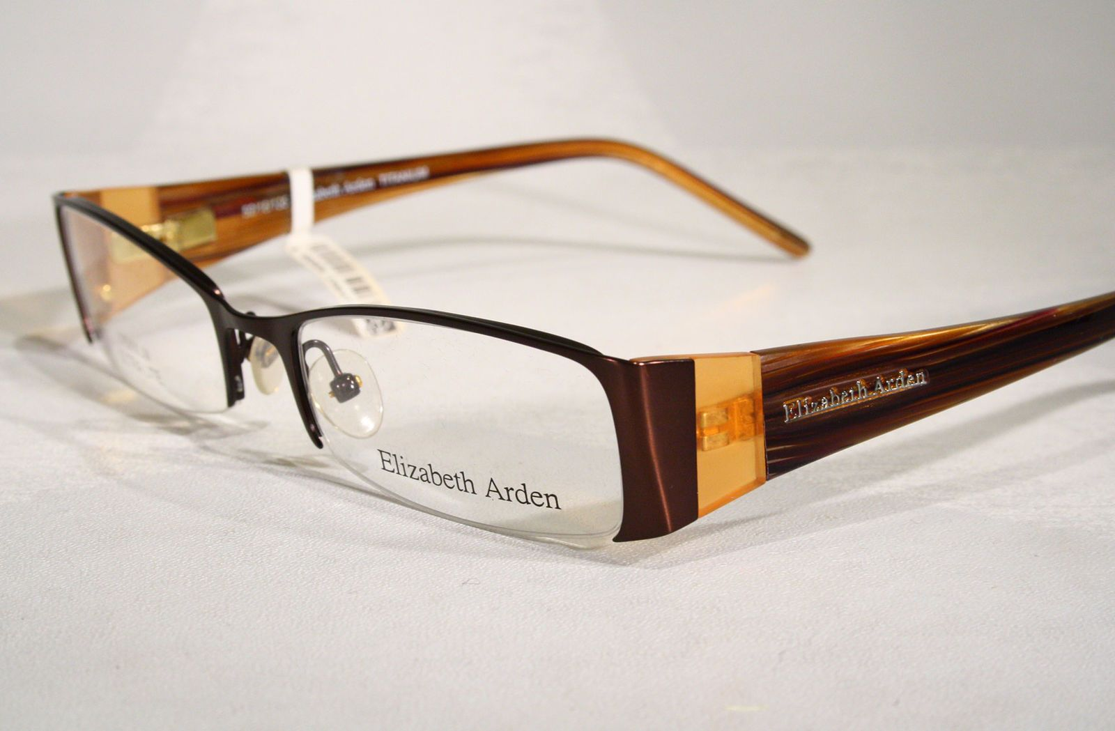 37919a97b Titanium Semi Rimless ELIZABETH ARDEN Women's Copper Brown Eyeglass Frames  @ eBay (RipVanW)