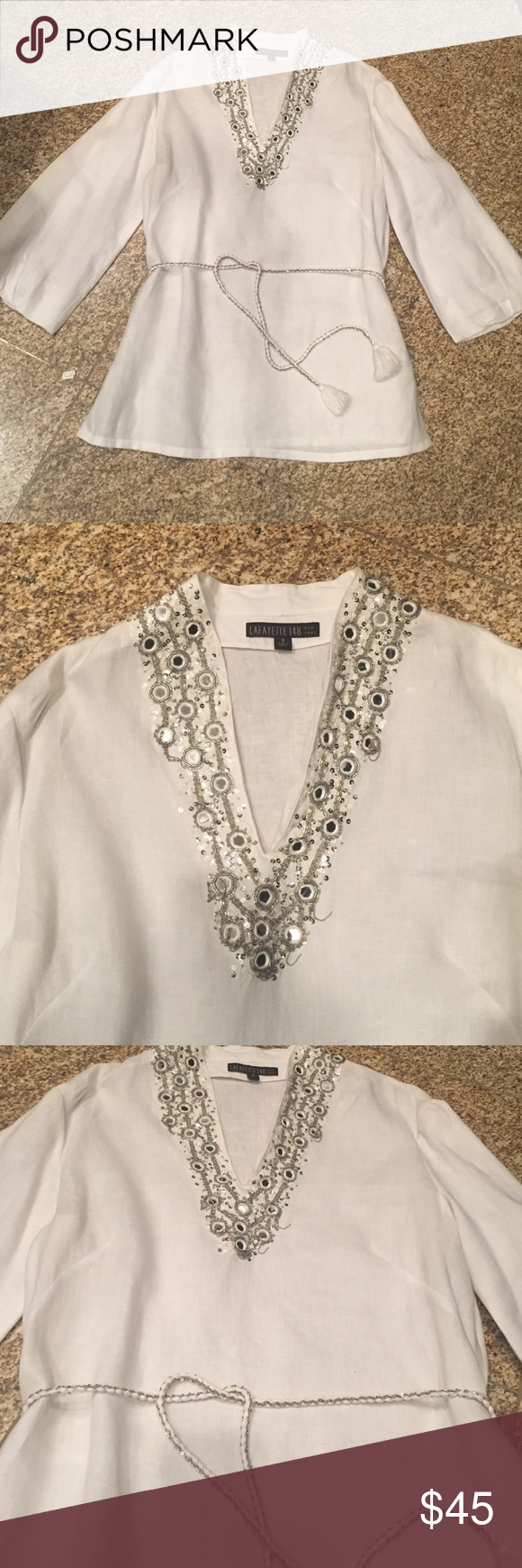 White Linen Tunic Blouse Lagayette 148 white linen tunic blouse... V- neck with sparkle detailing on V... Wide 3/4 sleeves... Braided belt.. Almost new... Wore once...aprox. 28 inches from shoulder down Lafayette 148 New York Tops Tunics
