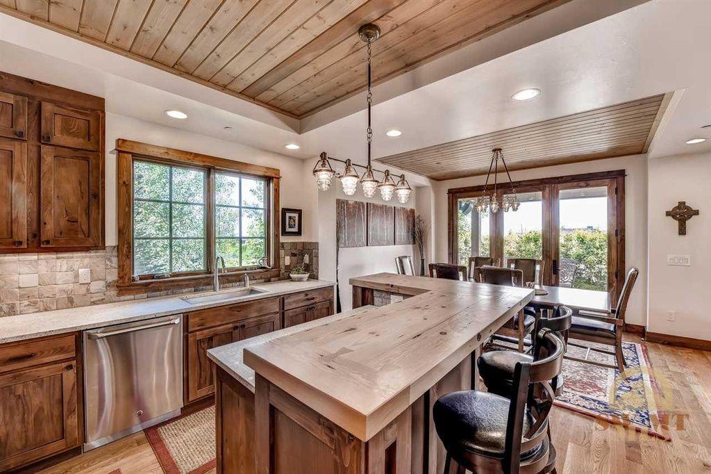 Craftsman Kitchen with Breakfast bar, Flat panel cabinets ...