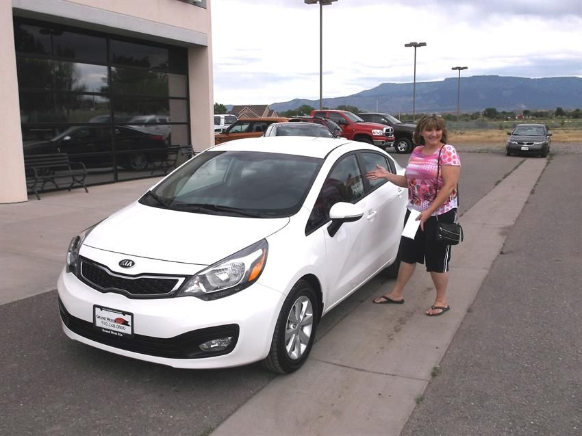 Laura's new 2013 KIA RIO! Congratulations and best wishes from Grand West Kia and Theron Bemis.