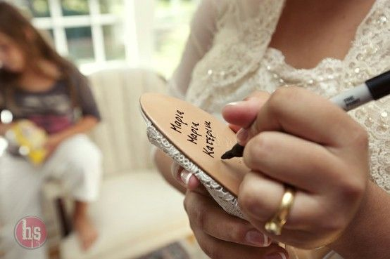 A tradition of writing the names of the single women at the wedding on the bottom of the bride's shoe - the name that lasts through all the dancing at the end of the night is the next to get married, they say!