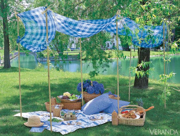 Why not convert this gingham canopy into a sweet booth covering? Instead of poles in the ground, they could be supported in weighted pots with short PVC inserts into which reeds or bamboo poles could be placed.