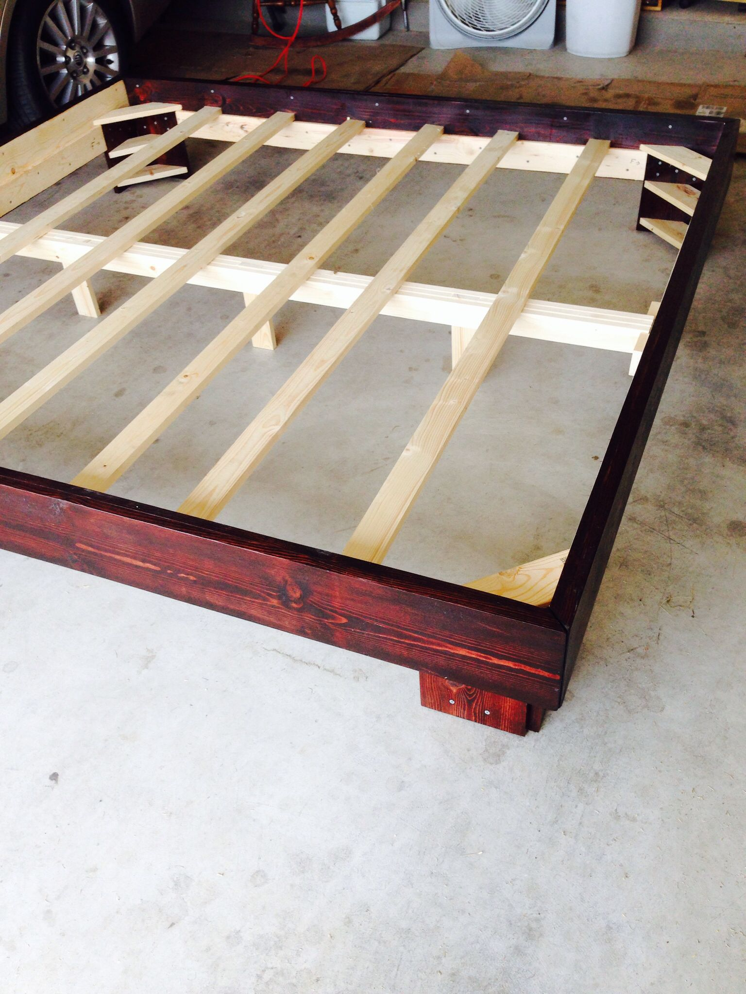 King size bed frame in Red Mahogany stain. Built to order