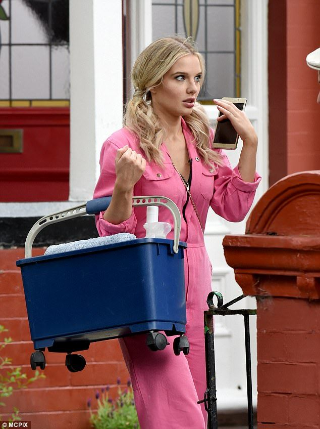 Oh dear: Rosie Webster's window cleaning job appears to have got off to a bad start on Coronation Street, as Helen Flanagan was seen filming tense scenes in her overalls on set