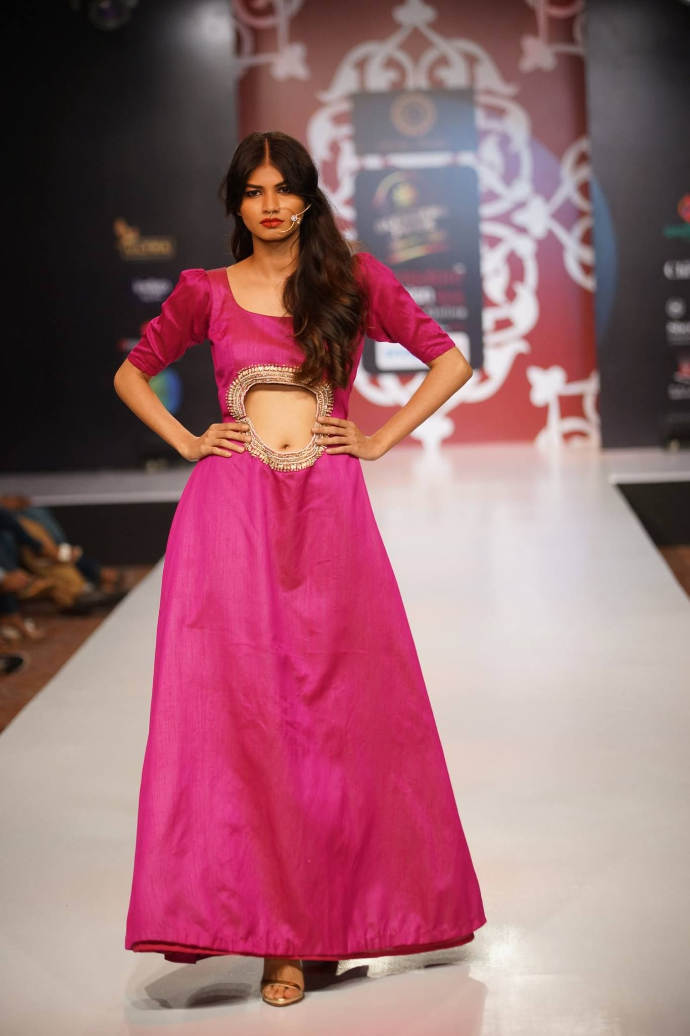 A royal #pink #gown with unique cuts, the nose-ring did added ...