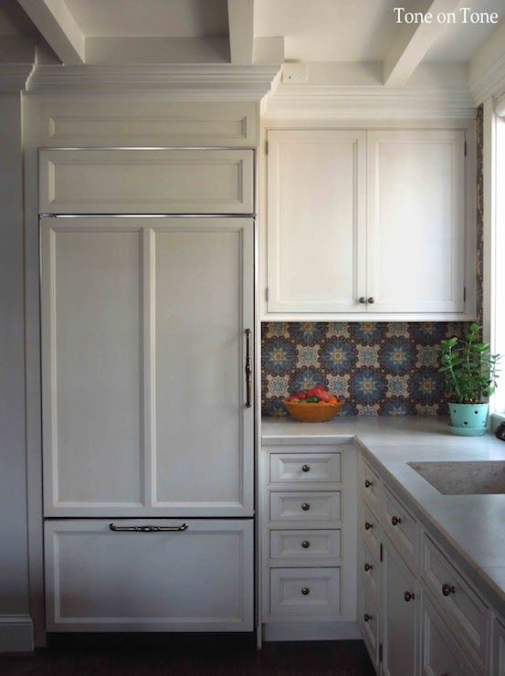 Stunning kitchen with inset cream cabinets adorned with brass ...