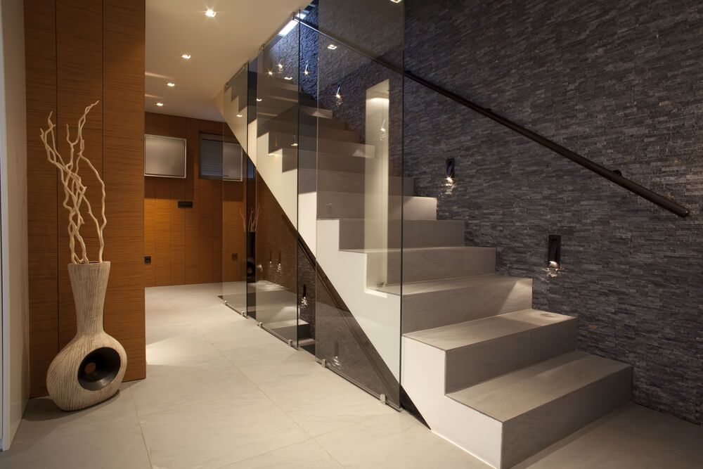 Open stringer modern straight staircase with no baluster; although the open side has partial glass walls.