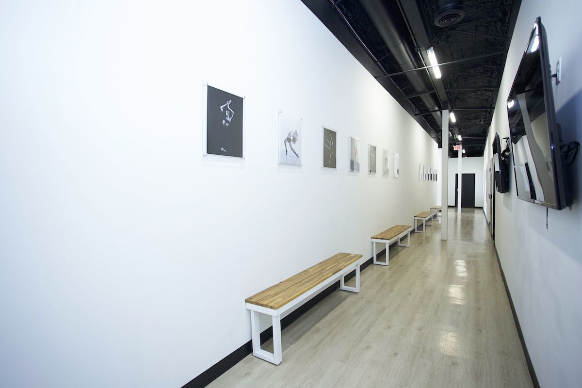 Elite Dance Studio Hallway With Wooden Benches White Walls And Black And White Photography With Tvs Dance Studio Design Dance Studio Decor Dance Studio Floor