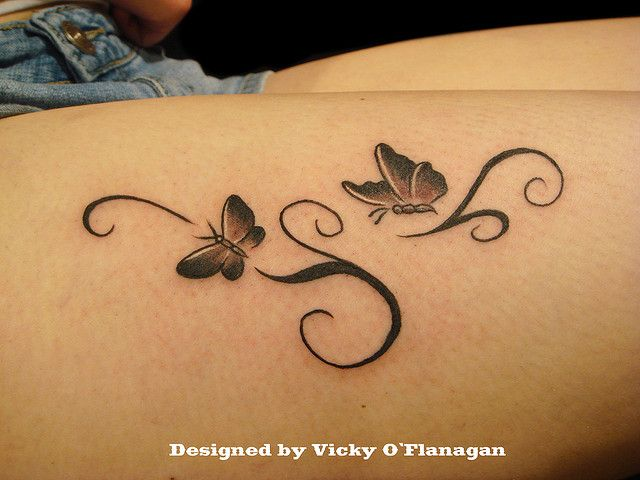 Photo of butterfly and pattern tattoo