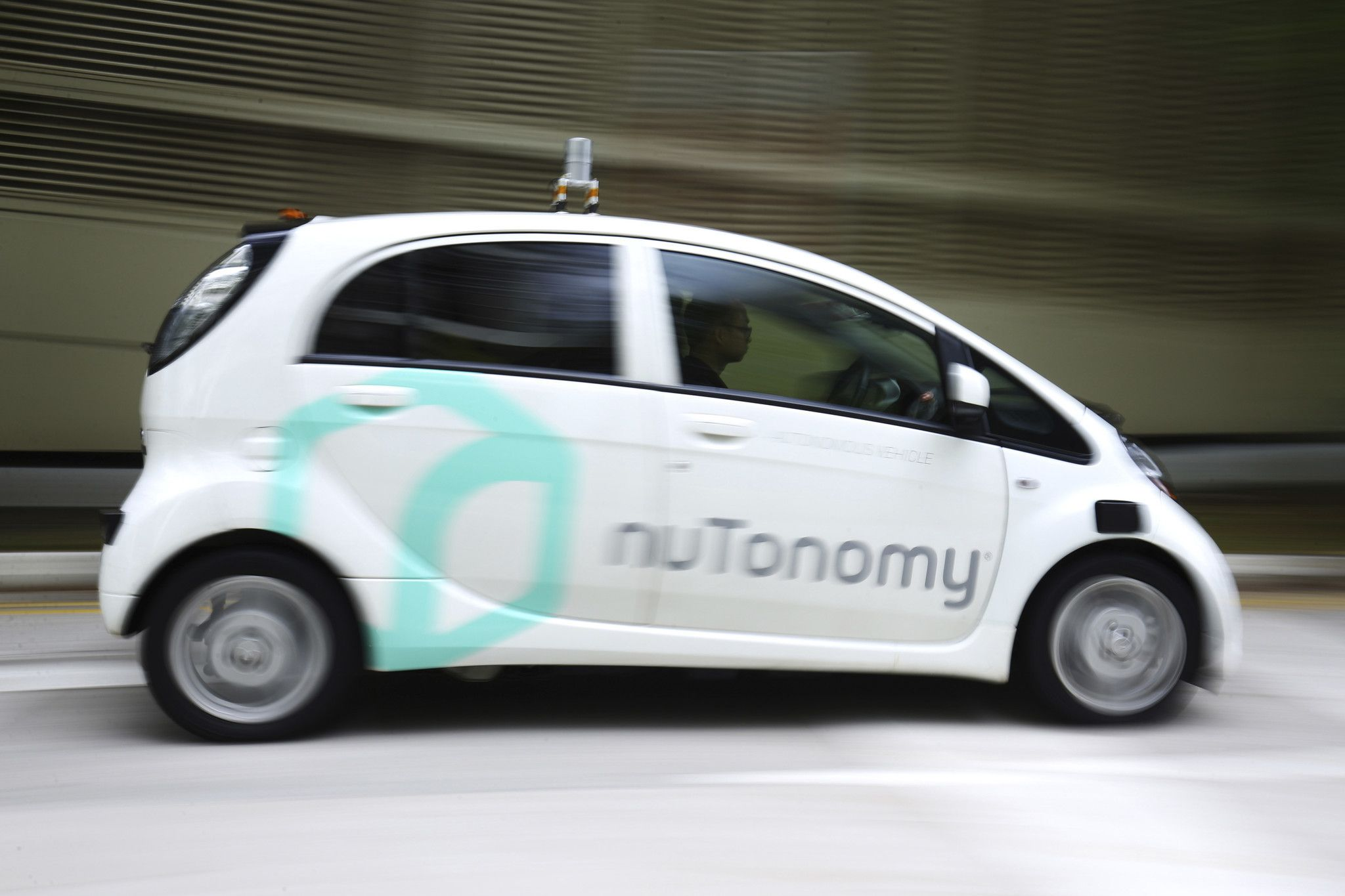 World's first self-driving taxis debut in Singapore - LA Times