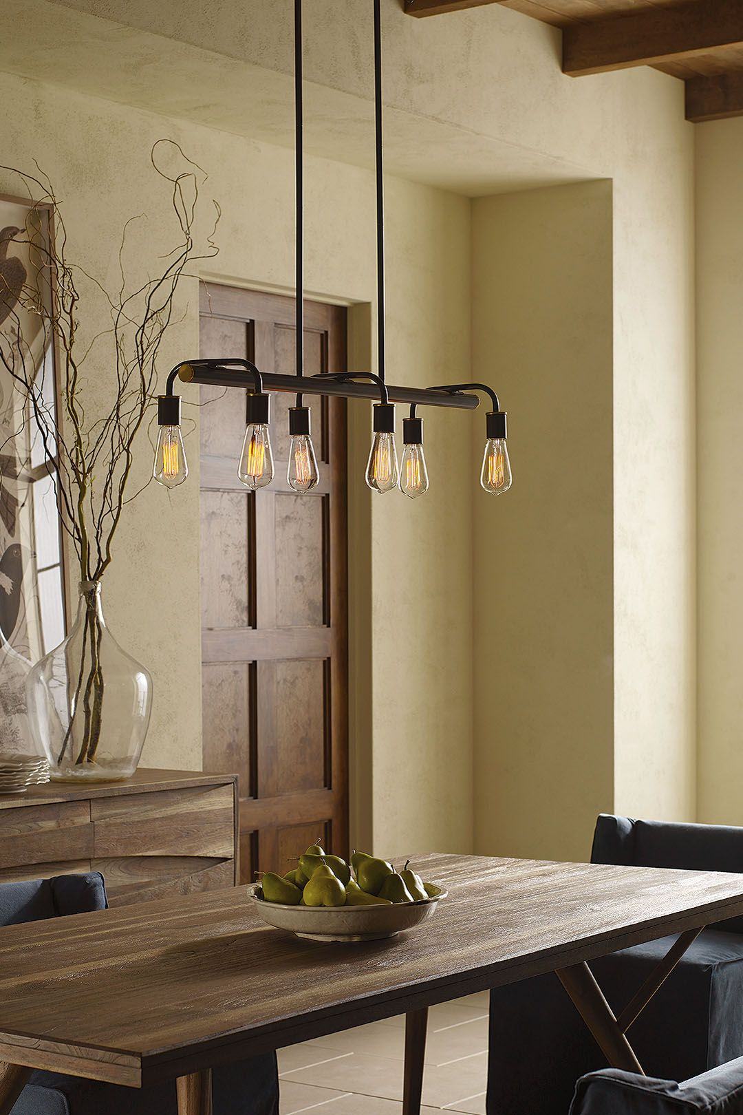 Now Trending Edison Bulbs And Industrial Lighting Styles A Linear Chandelier With Vintage Rustic Dining RoomsIdeas
