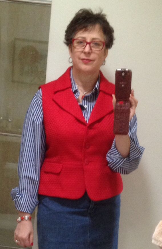 Jacket transformed into a vest by Michelle Paganini. Rip out the sleeves and remove the padding. Lower the armhole. Widen the armhole especially in the back. Take in the princess seams and shoulder seam to get the armhole to lay against the body. Turn under the armhole seam, hand baste then finish off with bias tape.