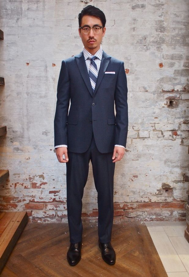 Hilton Solid Stretch Wool Suit w/ Peak Lapel: $898 Gotstyle Silk Tie: $120 Gotstyle Check Shirt: $165 Armstrong & Wilson Linen Pocket Square...