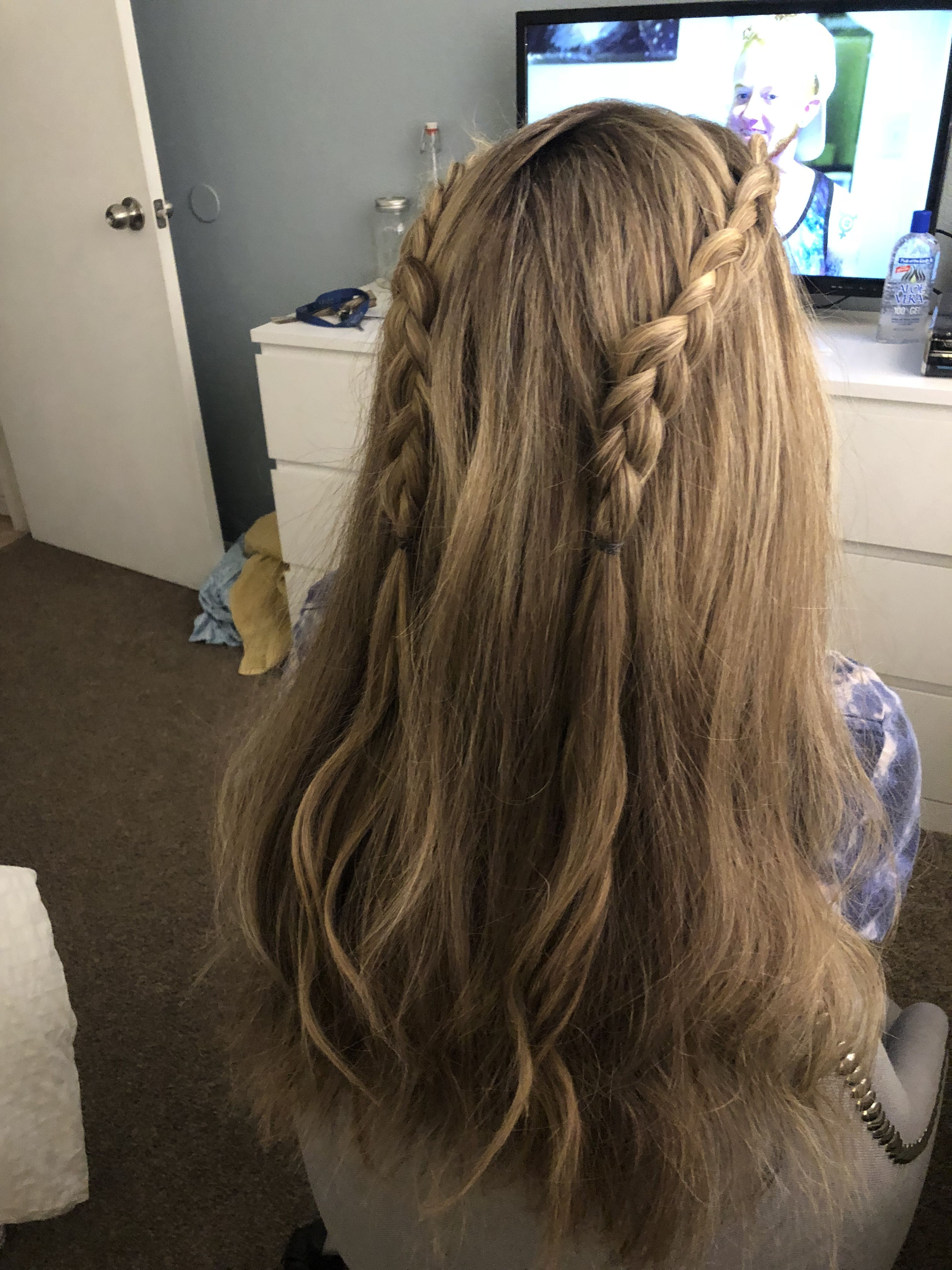 Make two side braids for a festive fun playful style Hair in