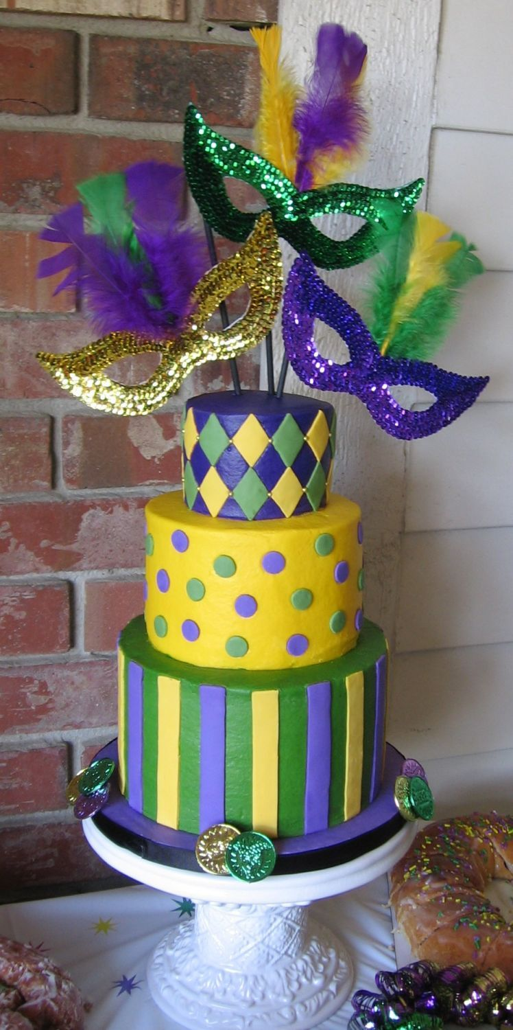 3tiered Mardi Gras cake w buttercream frosting and fondant accents