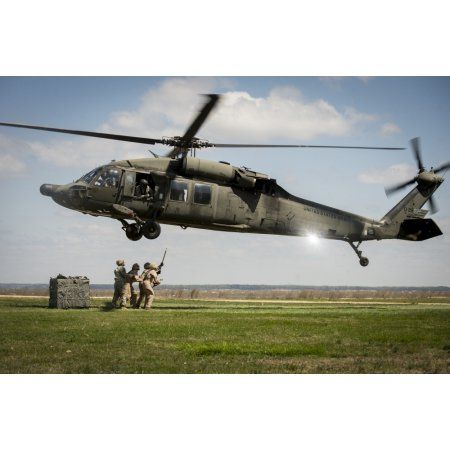 US Marines prepare to attach cargo under a UH-60 Black Hawk Canvas Art - Stocktrek Images (34 x 23)