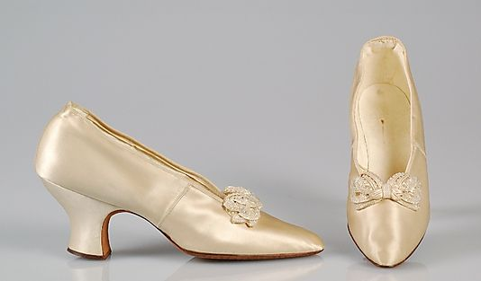White silk satin wedding pumps with glass bead bows, by J&J Slater, American, 1904.