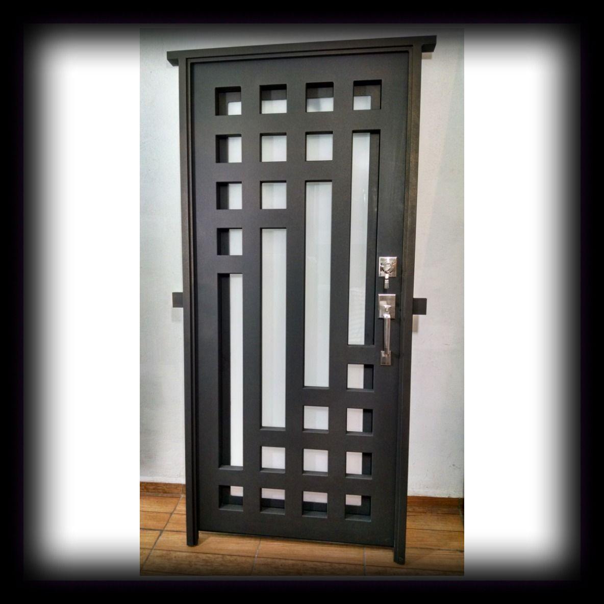 Puerta principal de forja contemporanea paulino lara for Puertas de metal para interiores