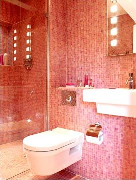 Modern bathroom with pink mosaic tiled walls