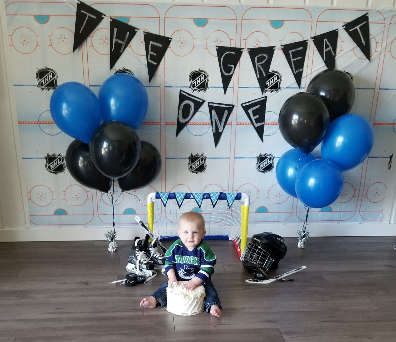First Birthday Hockey Themed Cake Smash With Images Hockey Birthday Parties Hockey Birthday Boys First Birthday Party Ideas