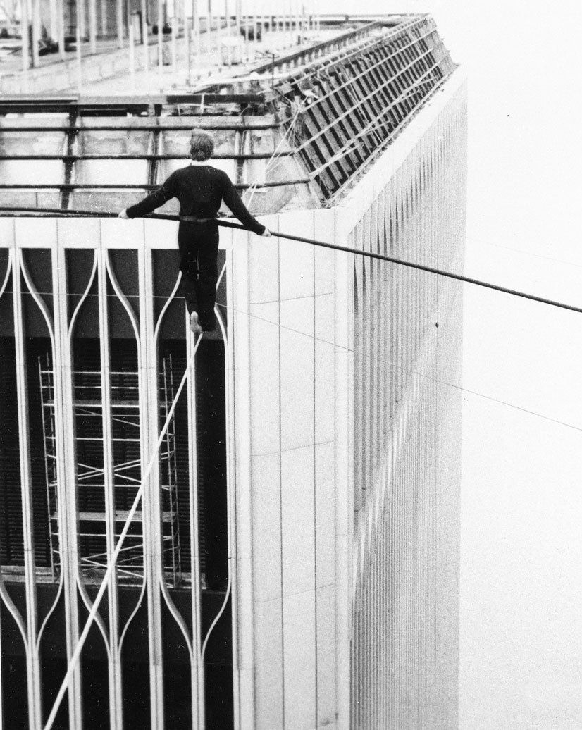 Philippe Petit walks across a high-wire between the Twin Towers of ...
