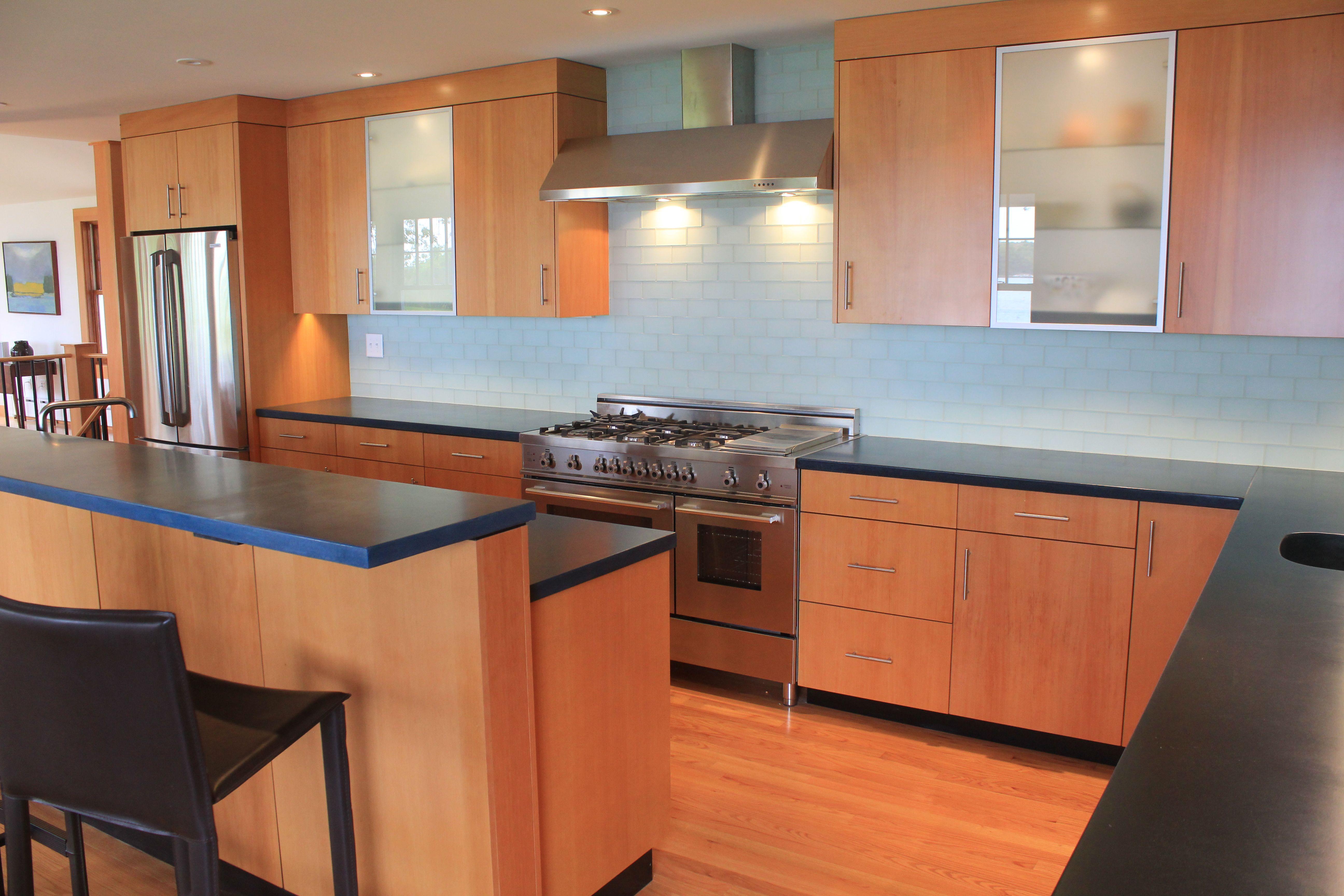Modern kitchen with Douglas fir veneer and concrete