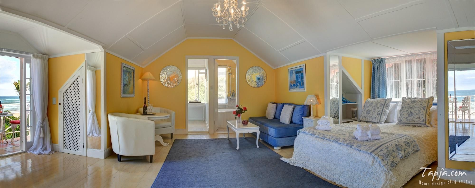 Bedroom Design Modern Attic Decoration With Yellow Paint Wall Color Plus Balcony Face To Beach Small Living Area Blue Sofa And Carpet