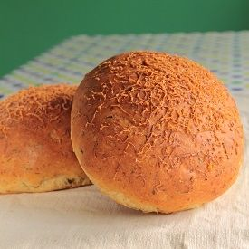 A round loaf of bread with a wonderful cheesy flavor that gets complimented deliciously with the sharpness of chives.