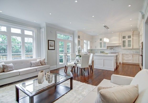 Can you imagine gathering in the light and airy family area? The open floor plan allows the kitchen to overlook a dining area and family room. Crown molding, custom kitchen cabinets, and recessed lighting complete the look.