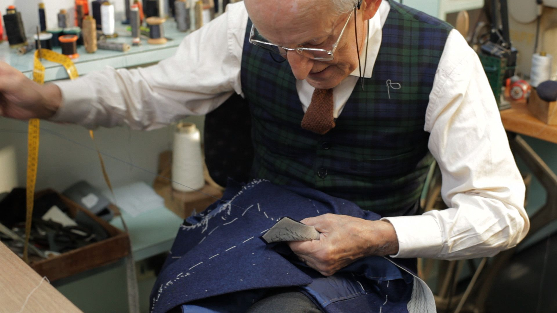 The master tailor Giovanni Barberis Organista bastes the suit.