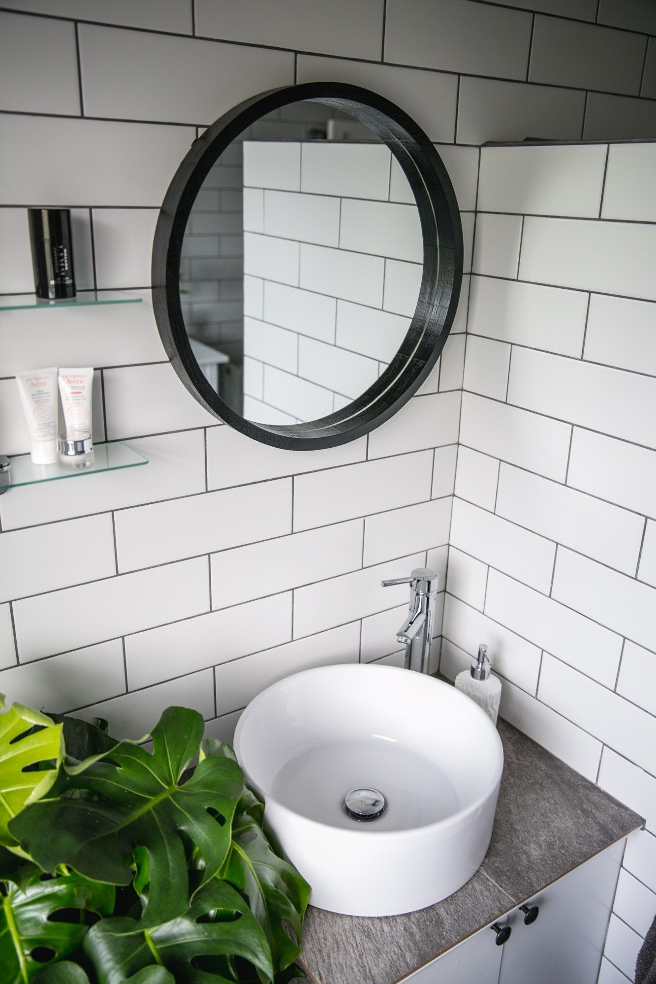 white tiles grey grout, roll top bath, monstera plant, round wall ...