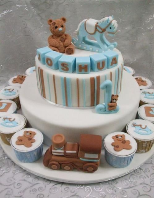 2 Tier Baby Shower Cake Surrounded By Cupcakes With Rocking Horse