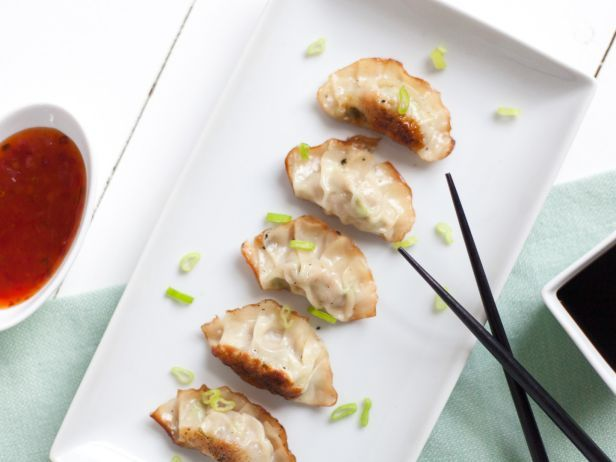 Pork Gyoza : Gyoza is basically the perfect food: It's both crispy and tender, and meant for dipping in savory sauce. Get the whole family involved in dumpling folding for a fun predinner activity (and faster prep!).