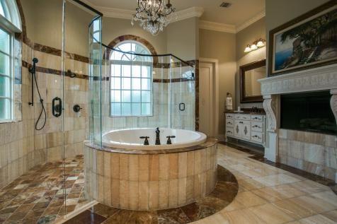 elegant master bathroom with circular bathtub