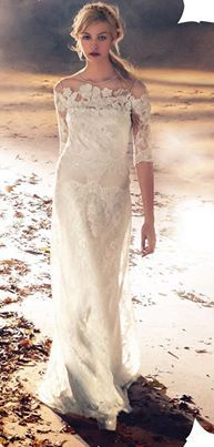 Kleinfeld Canada 3/4 length lace sleeves on this David Fielden sheath add a romantic touch.