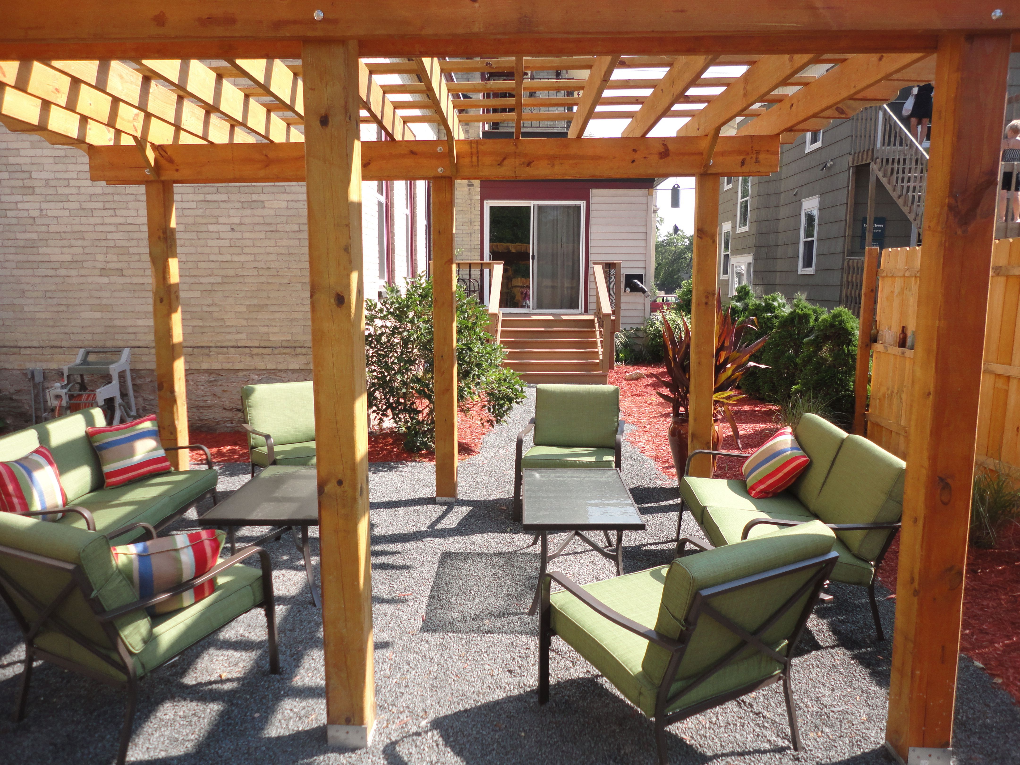 backyard outdoor seating under the pergola at Brayton Bed and ...
