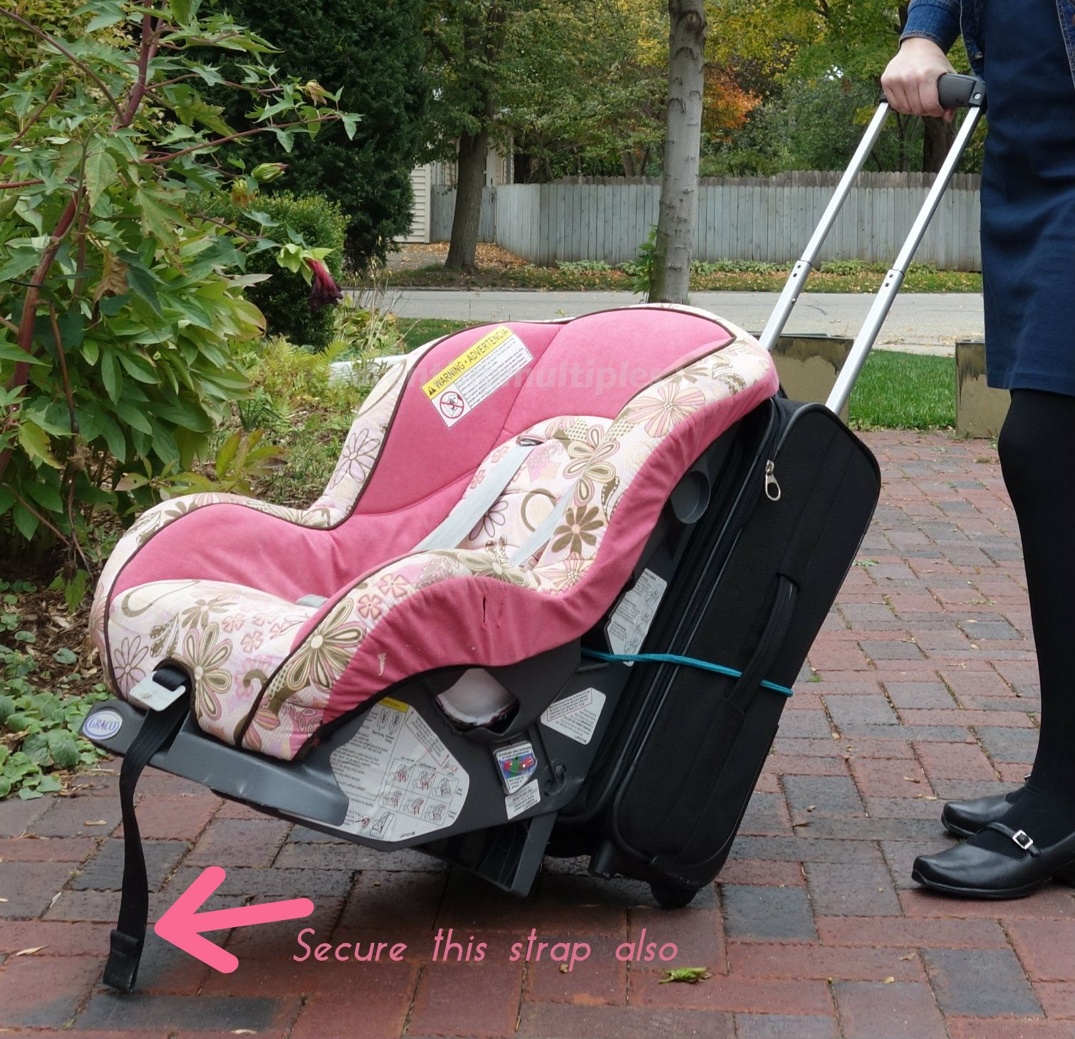 Secure A Carseat To A Suitcase With A Bungee Cord When